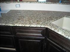 Venetian Pearl granite with dark cabinets