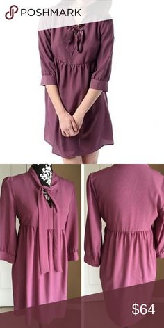 UrbanOutfitters Purple Dress Pins and Needles. Front tie around neck, Babydoll style dress. Has buttons on each sleeve. Fast shipping. Urban Outfitters Dresses