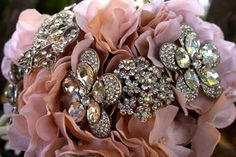 Google Image Result for http://photos.weddingbycolor-nocookie.com/p000030799-m190137-p-photo-485426/bouquet-pink-brooch.jpg