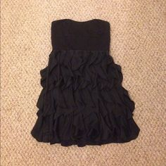 Black cocktail dress! Strapless, ruffle bottom. Super cute. Top is gently worn. Modeled in photo, but top is big on me so it does not fit as tightly as I like. LC Lauren Conrad Dresses