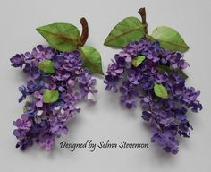 These lilacs created with Susan's Garden dies.  I have a tutorial on my blog on how I created them.  http://selmasstampingcorner.blogspot.com/2014/05/susans-garden-lilacs-with-tutorial.html