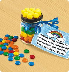 """Rainbow """"Pot of Gold"""" Share the bright colors of spring with this tasty rainbow treat! This activity is appropriate for: kindergarten - 2nd grade / 5 - 7 years You will need: Baby food jars with lids (one per student) Small candies in rainbow colors (red, orange, yellow, green, blue, purple) Yellow pom-poms Rainbow poem reproducible Tacky Glue Curling ribbon Hole punch Scissors"""