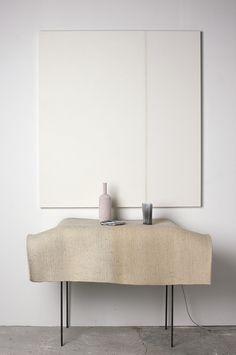 Minimal table, table cloth, metal table legs, white on white