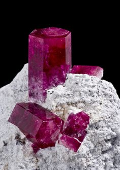 Red Beryl  Wahwah Mountains, Utah  1.5cm main crystal  Photographed for Exceptional Minerals  by Joe Budd