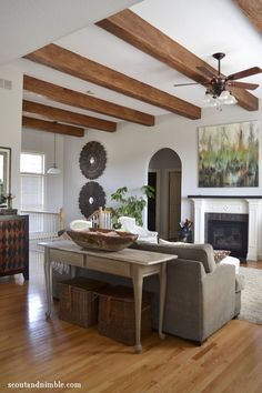 Living room and kitchen - wood beams and white walls.