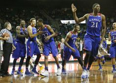 From left Jamari Traylor and Brannen Greene congratulate Andrew Wiggins, center, after Wiggins hit a long three-point basket to end the first half. Also celebrating at right are Wayne Selden and Joel Embiid Tuesday, Feb. 4, 2014 at Ferrell Center in Waco, Texas. #KU