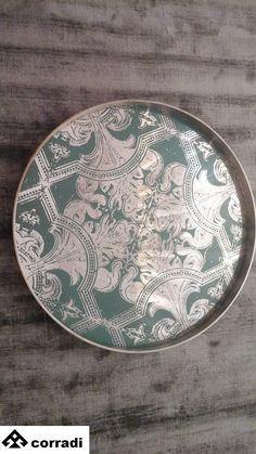 Dècor tray By Notre Monde wood and glass Diameter cm. 61 Wood: color silver Glass: color turquoise Price: € 150.00