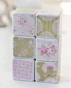 This is a set of six 1 and 1/2 inch blocks that have been painted white, and decorated with beautiful shabby paper from 2 new Tilda collections. Each block and the decorative paper has been lightly sanded for a distressed look. Each block has been sealed with a protective, non-toxic varnish. Please be aware that the placement of patterns may differ slightly from the images.  *Please note that although these blocks have been constructed with non-toxic materials, they are not intended to b...