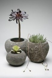 Carved river rock plant pot with natural color and shade variations.