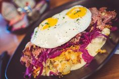 Hot Mess! housemade smoked pastrami, potatoes, sawmill gravy, 2 fried eggs your way + honey-braised cabbage