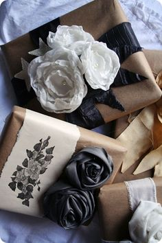 wrap with burlap or brown paper and embellish with flowers, ribbon, doilies, or stamps on paper.