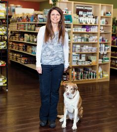 Healthy Pet Products, located in Pittsburgh's North and South Hills, offers the largest selection of raw pet foods in the region. Shown here are owner Toni Shelaske and her rescued pup, Meg.