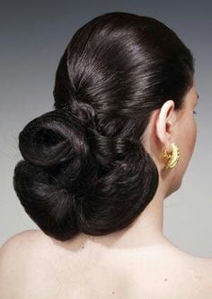 Updo buns at nape of the neck are gives the most feminine look.