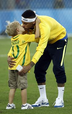 Brazil's forward Neymar kisses his son after the Rio 2016 Olympic Games men's…