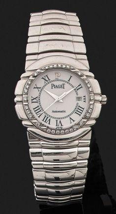 PIAGET TANAGRA ANNEES 1990 Montre bracelet de dame en or gris godronné. Cadran blanc avec ind | juwelier-haeger.de