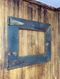 Rustic barn wood picture frame with old rusty hardware