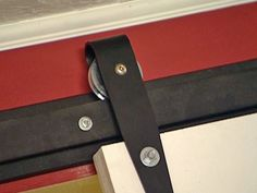 HOW TO HANG AN INTERIOR BARN DOOR TRACK SYSTEM.. I am in love with barn doors so this is good to know!
