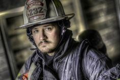 Portrait of fireman getting ready to go to work. I like how the colors where softened with a little HDR.