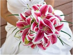 The dual-tone effect of stargazer lilies make for a bold statement. There is really no need to include any other flowers!