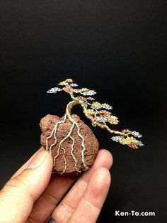This is a cascade on a rock in 3 colors. wire mame bonsai tree by Ken To on a rock Bonsai Wire, Mame Bonsai, Wire Tree Sculpture, Crystal Tree, Wire Trees, Metal Tree Wall Art, Handmade Wire, Wire Crafts, Wire Art