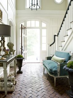 Amy Morris - Interior Designer - Atlanta -Traditional - Transitional - Foyer - Entryway - Staircase - Door - Glass - Lantern - Light - Lamp - Couch - Neutral - Blue - Green - Brick Floor - Rustic