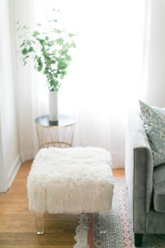A cozy fur ottoman:  http://www.stylemepretty.com/living/2015/11/30/a-dress-shop-so-pretty-we-want-to-move-in/ | Photography: Matthew Land Studios - http://matthewland.com/
