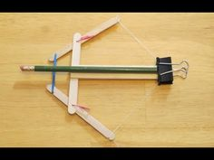 How to make a Rubber Band Powered Crossbow  (Watch Video)  This mini crossbow was made from the mini bow in my last video.  http://www.youtube.com/watch?v=PDLCeBQqEpc The original bow is easily modified to create this crossbow. You can adjust the power of the crossbow by simply changing out the rubber band for a stronger one.  (Be very careful with this toy, it can be very dangerous, so please do not shoot at anyone or yourself). DIY homemade toys  www.specificlove.com