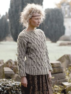 Glacier - Knit this ladies cable sweater from Rowan Knitting & Crochet Magazine 58, a design by Martin Storey using the super soft yarn Brushed Fleece (extra fine merino wool and baby alpaca.) With an all over chunky cable pattern and ribbed edgings, this knitting pattern is suitable for the more experienced knitter.