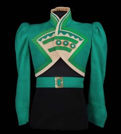"""Emerald-green felt Ozmite jacket designed by Gilbert Adrian, from """"The Wizard of Oz"""" (1939)."""