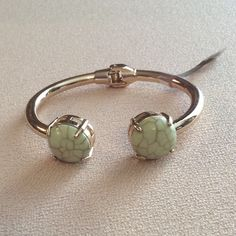 NWT Sage green & gold toned hinge bangle bracelet Crackled simulated stones. Gold toned band. 80% metal, 20% other. Tag came exactly as seen in pic 2.   zxonsvqw Chico's Jewelry Bracelets