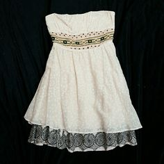 Free people strapless tunic dress Absolutely gorgeous boho strapless free people dress/tunic. Very pale pink with embroidered bodice. Layered hem. Side zipper and ruching on the back. Fully lined. Free People Dresses