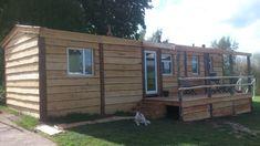 Caravan cladded to look like a log cabin