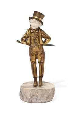 THE YOUNG GENTLEMAN' A GEORGE OMERTH GILT-BRONZE AND IVORY FIGURE  CIRCA 1910  modelled, cast and carved as a boy with hat and cane, on marble base, signed Omerth 7¾ in. (19.7 cm.) high