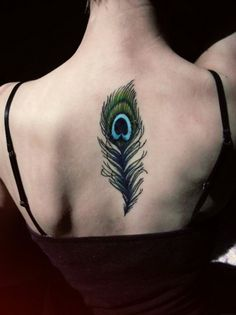 Lovely black peacock feather tattoo for girls on back