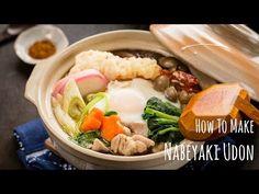 Savory nabeyaki udon topped with chicken, carrots, shrimp tempura, kamaboko, and mushrooms in an umami dashi soup.