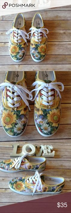 ❗️FLASH SALE❗️The Bradford Exchange 9 canvas shoes The Bradford Exchange women's size 9 canvas tennis shoes with floral print and gold butterfly charms. Excellent condition. No rips holes or stains. Never worn. A wearable work of art. Beautiful shoes! Perfect for spring and summer!   I ship fast! Pay before 4:30pm Monday thru Friday and I will ship the same day!  Thank you for looking!  Check out my other items! The Bradford Exchange Shoes Sneakers