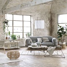 Warehouse Living room in white, even the brick wall.