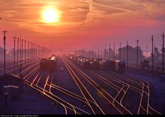 The sun rises over Bellevue and when it goes higher it changes the colors of the shining rails it touches, here a kind of coppery gold.