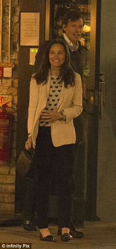 Looking good: The 31-year-old was pretty in a tailored cream blazer, denim jeans and a heart-print top
