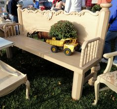 a re-purposed bench-- upside down foot board (with crib parts for arms-like gail@myrepurposedlife uses)