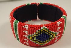 Handcrafted African Zulu beaded bangles made by the tribal Zulu women of South Africa.  Materials: Glass beads Colors: Ethnic traditional Zulu colors: blue, red, yellow, turquoise, white, orange, green, lime etc. Beaded Bangles : size - opens to fit all sizes   **Please note that our products are hand crafted and colors and sizes may vary slightly.