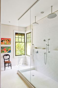 This Georgia bathroom breaks all the rules with windows sans window treatments, no bathtub, and punches of color through artwork. The extra-large shower is enclosed with clear sheets of shatterproof glass. Shelf in the shower! Big Shower, Double Shower, Large Shower, Glass Shower, Shower Window, Dream Shower, Shower Rooms, White Shower, Shower Floor
