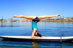 Tarsan Stand-up Paddleboarding's Amy McCool teaches yoga classes on stand-ups in King Harbor. Photo by Brad Fyffe