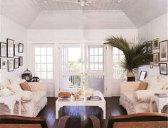 india hicks - love the flooring with white walls, palm and frames