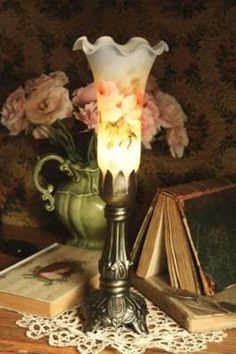 I wish I could find a shade like this one:) beautiful little lamp