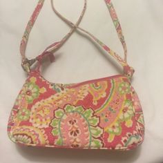 "Vera Bradley Handbag Small handbag more like a small clutch. Measurement wise 8.25"" L x 2"" wide x 4.5"" high No holds swaps trades Vera Bradley Bags"