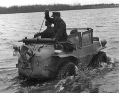 A soldier getting ready to lower the propeller mechanism into the water on the VW Type 166 Schwimmwagen