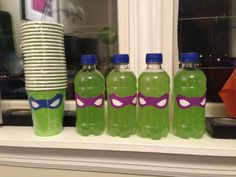 TMNT decoration drinks. Green drinks with taped with masks. Greed drinks were small bottles of Hawaiian Punch Green Berry Rush.