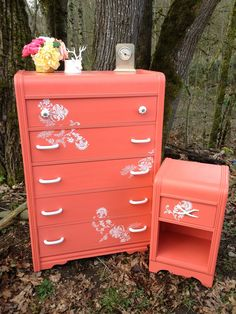 Vintage waterfall dresser and nightstand painted a vibrant coral. White modern floral detail work. By URBANCottage