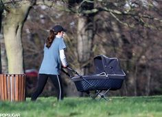 13.02.2014 - The Duchess of Cambridge takes her dog, Lupo, and her son, Prince George, out for a walk in London.